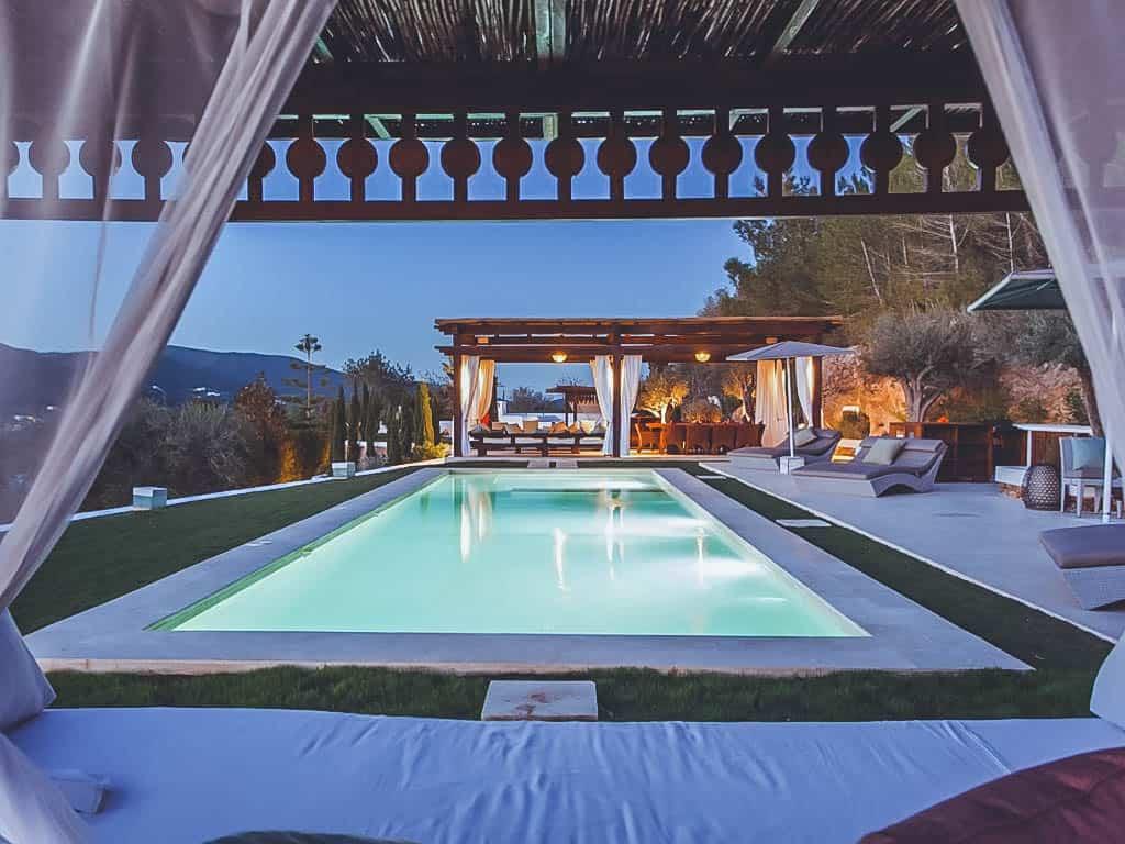 Villa Rental Ibiza - 4 Bedrooms - Balearic Bliss - Can Alivia - pool at night and chillout